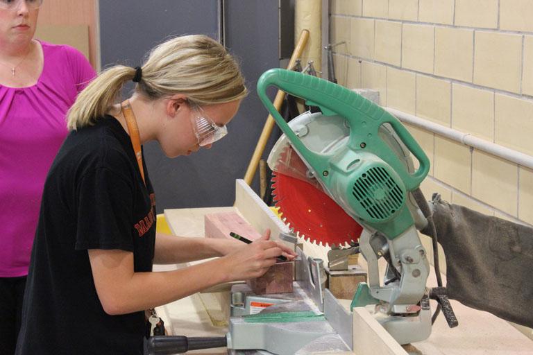 Student Using Saw at Ladies Night